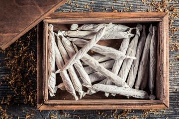 Handmade cigarettes in wooden box