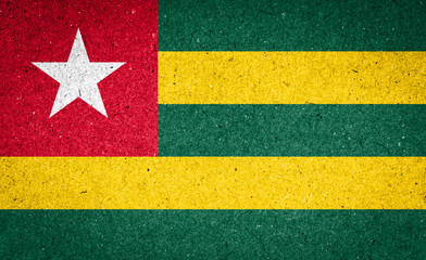 Togo flag on paper background