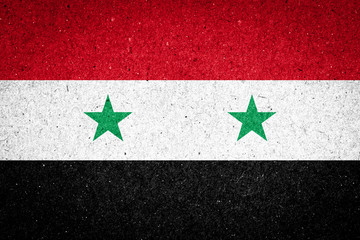 Syria flag on paper background