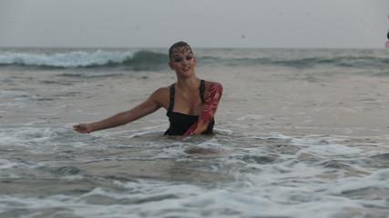 Girl Performers dance acrobatic stunts in the water