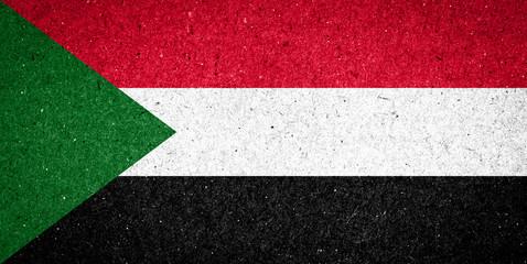 Sudan flag on paper background