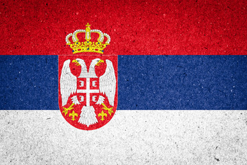 Serbia flag on paper background