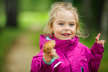Happy little girl with a mushroom
