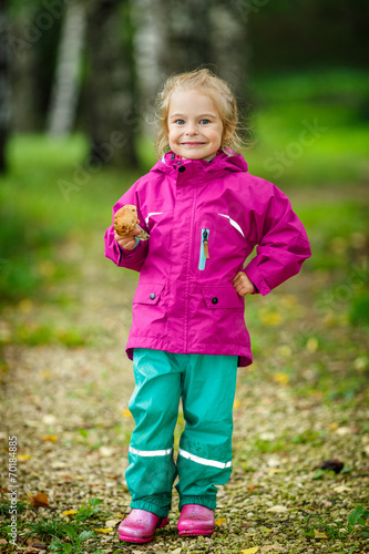 canvas print picture Happy little girl with a mushroom