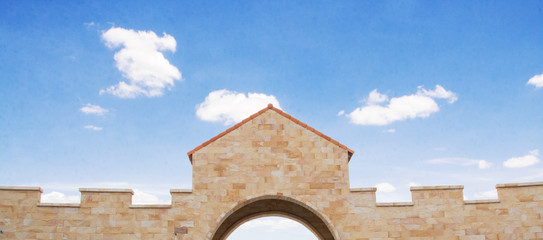 archway of castle from brickwall and sky