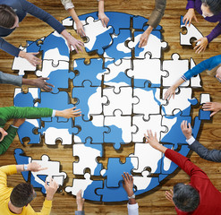 People with Jigsaw Puzzle Forming Globe