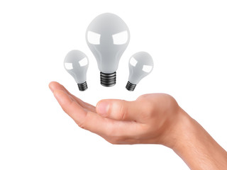man holding light bulb. success in business