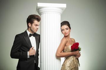 elegant man looking at his woman