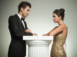 elegant man and woman  look at each other