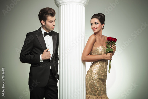 canvas print picture young elegant couple looking at each other near column