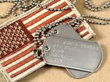 Military dog tags and camoflage flag - 70186804