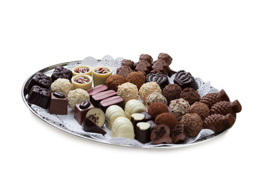 Dish with lot of tasty chocolate candies