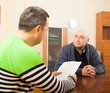 adult   men talking  with documents