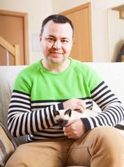 man sitting   with  kitten