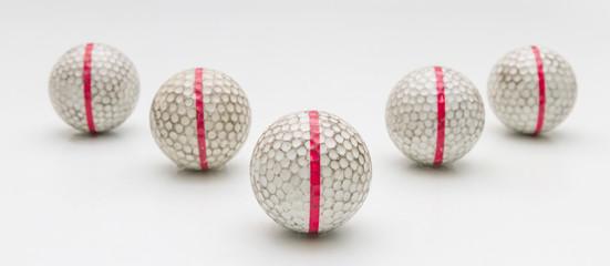 Five Old golf balls.