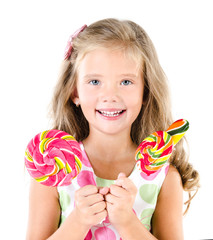 Happy little girl with lollipops isolated