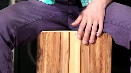Close up footage of drumming on cajon