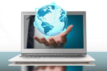 glowing orbit globe in plam through laptop