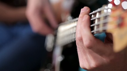 Men playing on bass close up footage