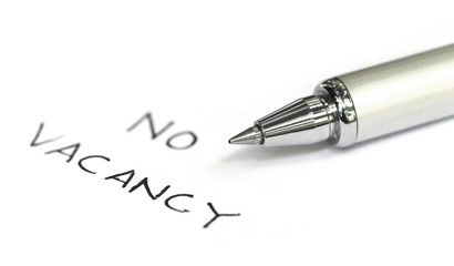 No vacancy written on a white paper