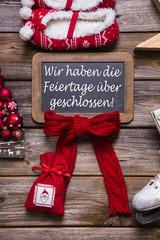 Schild für Kunden: Betriebsurlaub an Weihnachten