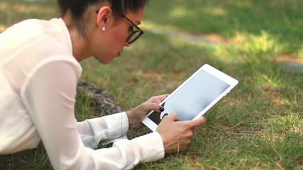 Girl with Tablet in the Garden