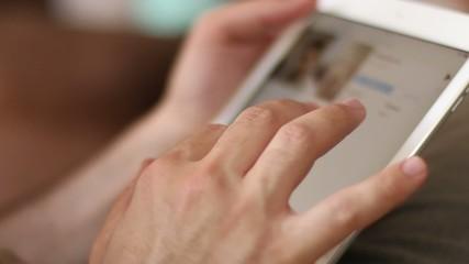 Man Browsing Tablet Computer