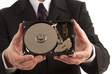 Businessman showing hard drive