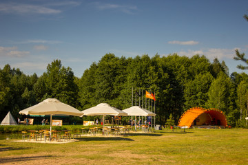 Tents in the tourist camp in a forest glade.