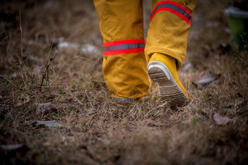 firefighter suit walking on grass