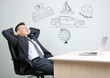Dreaming concept. Portrait of young businessman in office
