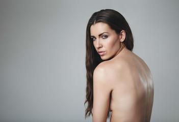 Beautiful naked woman looking at camera