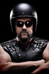 Vertical shot of a male biker with helmet
