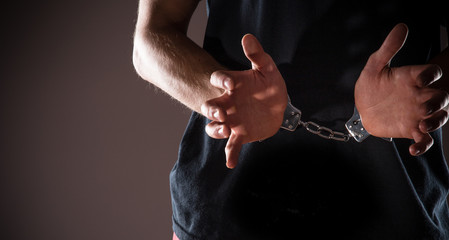 Man handcuffed hands
