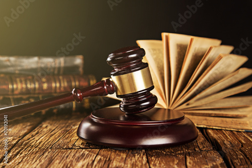Wooden gavel and books on wooden table - 70192041