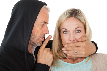 Close up of theft covering womans mouth
