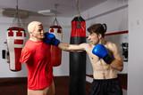 Fototapeta Boxer training in the gym