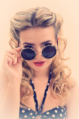 Beautiful glamour girl in retro style