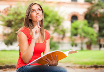 Smiling student studying outdoors