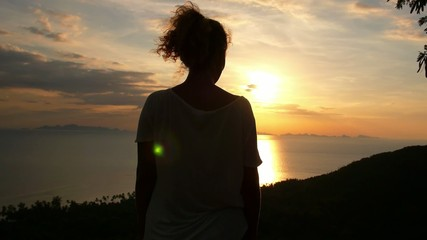 Woman Admiring the Sunset over the Sea. Slow Motion.