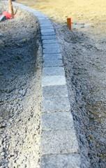 alignement de pavés en granit,,construction de bordures