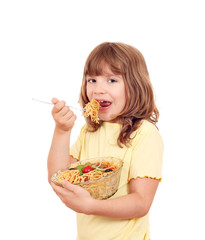 hungry little girl eat spaghetti