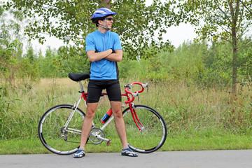 male cyclist with race bike
