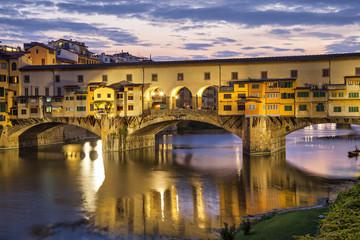 Ponte Vecchio bridge in evening illumination