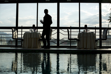 silhouette of a man by the hotel swimming pool