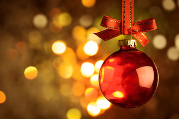 Christmas red bauble over magic bokeh  background