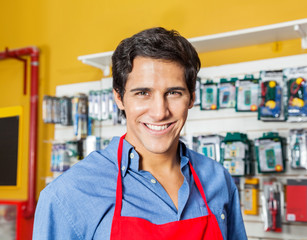 Handsome Worker Smiling In Hardware Shop
