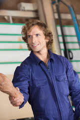 Confident Carpenter Shaking Hands With Colleague