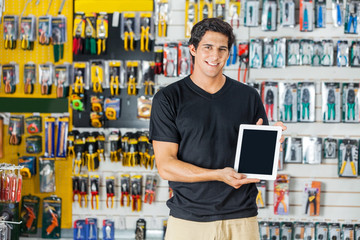 Man Showing Digital Tablet In Hardware Store