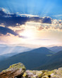 majestic Sunrise over the mountains  with sunbeams - vertical